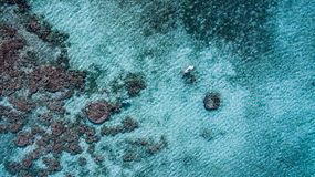 Aerial of canoes over a reef Stock Photos