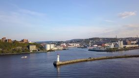 Aerial Capture with Circular movement around Lighthouse on Jetty in Trondheim Port, Norway. Sunset Colours stock video