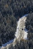 Aerial of a car on road in a forest with snow stock image