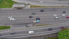 Aerial car traffic driving the busy city freeway, vertical shot. Stock footage stock video