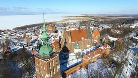 Castle of Frombork in Poland. Aerial: Castle of Frombork in Poland at winter time stock footage
