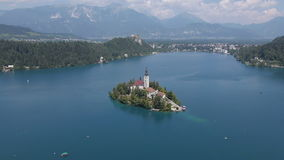 AERIAL: The church of Bled stock video footage