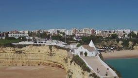 Aerial from the church  Senhora da Rocha in Armacao de Pera, Algarve, Portugal. stock footage