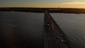 Aerial cinematic sunset fly over a Southern Bridge in Riga, Latvia - Golden hour professional drone shot. In beautiful light stock video