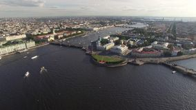 Aerial cinematic view of st. Petersburg city. Neva river panorama. Rostral Columns in St. Petersburg, Russia. Quadcopter drone unique high altitude flight over stock footage