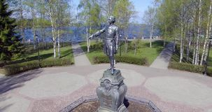Aerial circling bronze Russian Tzar Peter the Great in city park stock video
