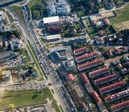 Aerial vehicles on road and buildings. Aerial city scene - Buildings roofs, road and vehicles. Traffic jam, living city, many vehicles stock photos
