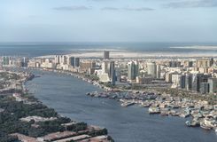 Aerial city skyline and creek from helicopter, Dubai.  stock images