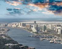 Aerial city skyline and creek from helicopter, Dubai.  stock photography