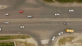 Aerial - City traffic, cars, trucks, buses on the road. The action in the real time stock video