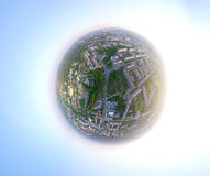Aerial city view from air - little planet mode Royalty Free Stock Images