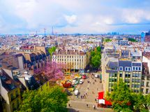 Aerial city view of beautiful buildings on the horizon in spring in Paris Stock Image