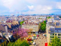 Aerial city view of beautiful buildings on horizon in spring in Paris,View on Eiffel Tower,Business Center La Defense,Paris,France stock images
