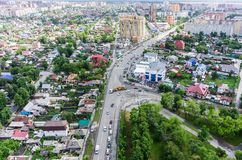Aerial city view on crossroad, carshop and houses Stock Images