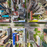 Aerial city view with crossroads and roads, houses buildings. Copter shot. Panoramic image. Royalty Free Stock Photos