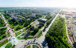 Aerial city view with crossroads and roads, houses buildings. Copter shot. Panoramic image. Stock Photos
