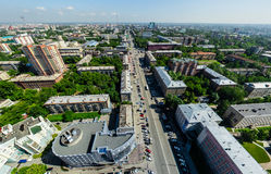 Aerial city view with crossroads and roads, houses buildings. Copter shot. Panoramic image. Royalty Free Stock Images