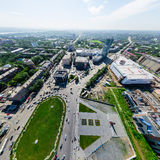 Aerial city view with crossroads and roads, houses buildings. Copter shot. Panoramic image. Royalty Free Stock Image