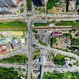 Aerial city view with crossroads and roads, houses buildings. Copter shot. Panoramic image. Stock Photography