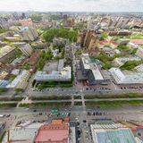 Aerial city view with crossroads and roads, houses buildings. Copter shot. Panoramic image. Aerial city view with crossroads and roads, houses, buildings, parks Stock Photo