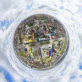 Aerial city view with crossroads and roads, houses buildings. Copter shot. Panoramic image. Aerial city view with crossroads and roads, houses, buildings, parks Stock Photos