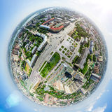 Aerial city view with crossroads and roads, houses buildings. Copter shot. Panoramic image. Royalty Free Stock Photography