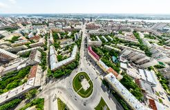 Aerial city view with crossroads and roads, houses, buildings, parks and parking lots. Sunny summer panoramic image Royalty Free Stock Images