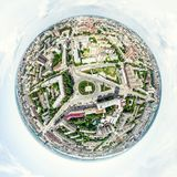 Aerial city view with crossroads and roads, houses, buildings, parks and parking lots. Sunny summer panoramic image Royalty Free Stock Image