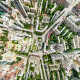 Aerial city view with crossroads and roads, houses, buildings, parks and parking lots. Sunny summer panoramic image. Aerial city view with crossroads and roads Stock Image