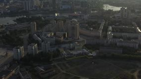 Aerial city view with crossroads and roads, houses, buildings, parks and parking lots, bridges. Urban landscape.  stock footage