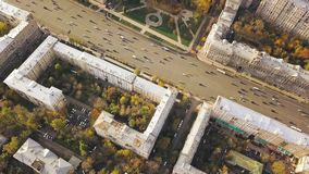 Aerial city view with crossroads, roads, houses, buildings, parks and parking lots. Clip. Top view of the wide road in. The city stock footage