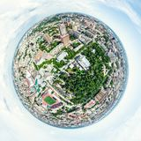 Aerial city view with crossroads and roads, houses, buildings, parks and parking lots. Sunny summer panoramic image. Aerial city view with crossroads and roads Stock Images