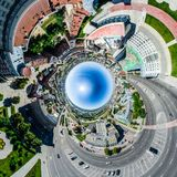Aerial city view with crossroads and roads, houses, buildings, parks and parking lots. Sunny summer panoramic image. Aerial city view with crossroads and roads Royalty Free Stock Images