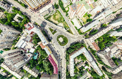 Aerial city view with crossroads and roads, houses, buildings, parks and parking lots. Sunny summer panoramic image. Aerial city view with crossroads and roads Stock Photography