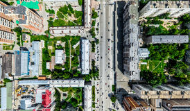 Aerial city view with crossroads and roads, houses, buildings, parks and parking lots. Sunny summer panoramic image. Aerial city view with crossroads and roads Royalty Free Stock Photo
