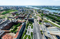 Aerial city view with crossroads and roads, houses, buildings, parks and parking lots. Sunny summer panoramic image. Aerial city view with crossroads and roads Royalty Free Stock Photos