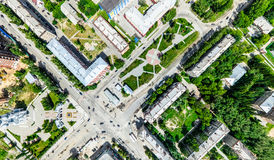 Aerial city view with crossroads and roads, houses, buildings, parks and parking lots. Sunny summer panoramic image. Aerial city view with crossroads and roads Royalty Free Stock Image