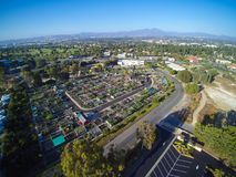 Aerial city view with roads, buildings, parks and parking lots. Panoramic image, drone shoot Stock Photography