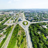 Aerial city view with roads, houses and buildings. Stock Images