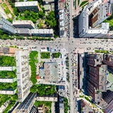 Aerial city view. Urban landscape. Copter shot. Panoramic image. Aerial city view with crossroads and roads, houses, buildings, parks and parking lots, bridges Royalty Free Stock Image