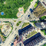 Aerial city view. Urban landscape. Copter shot. Panoramic image. Aerial city view with crossroads and roads, houses, buildings, parks and parking lots, bridges Stock Photography