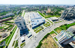 Aerial city view. Urban landscape. Copter shot. Panoramic image. Aerial city view with crossroads and roads, houses, buildings, parks and parking lots, bridges Royalty Free Stock Images