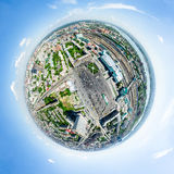 Aerial city view. Urban landscape. Copter shot. Panoramic image. Aerial city view with crossroads and roads, houses, buildings, parks and parking lots, bridges Stock Image