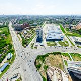 Aerial city view. Urban landscape. Copter shot. Panoramic image. Aerial city view with crossroads and roads, houses, buildings, parks and parking lots, bridges Stock Photos