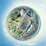 Aerial city view. Urban landscape. Copter shot. Panoramic image. Aerial city view with crossroads and roads, houses, buildings, parks and parking lots, bridges Royalty Free Stock Photos
