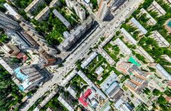 Free Aerial City View With Crossroads And Roads, Houses, Buildings, Parks And Parking Lots. Sunny Summer Panoramic Image Stock Photo - 121586100