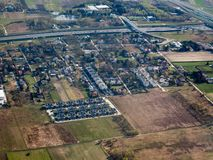 Aerial cityscape and buildings. Aerial cityscape visible buildings, houses, farming lands and highway from Poland sky stock photography