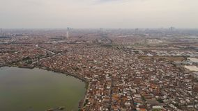 Surabaya capital city east java, indonesia. Aerial cityscape city Surabaya with skyscrapers, buildings and houses. urban environment in asia city skyline with stock photography