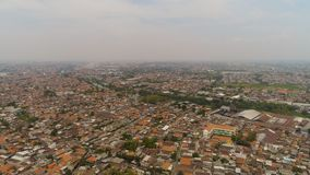 Surabaya capital city east java, indonesia. Aerial cityscape densely built asian city. modern city Surabaya with buildings and houses. Surabaya capital city east royalty free stock photo
