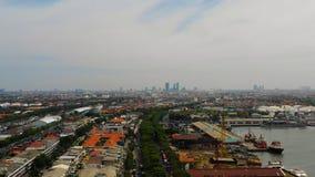 Surabaya capital city east java, indonesia. Aerial cityscape densely built asian city, seaport. urban environment in asia. modern city Surabaya with buildings stock photos